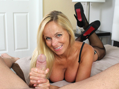 Blonde MILF gives a Handjob