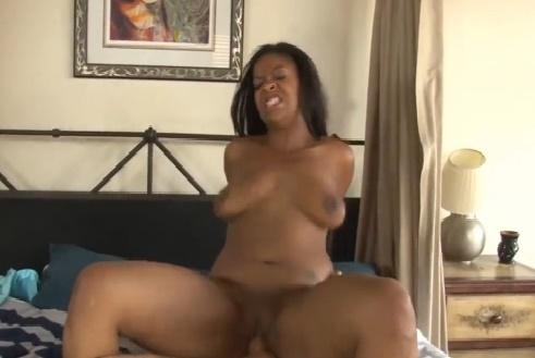 Black Babe Rides a White Cock Hard