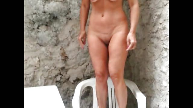 Wife nude on balcony