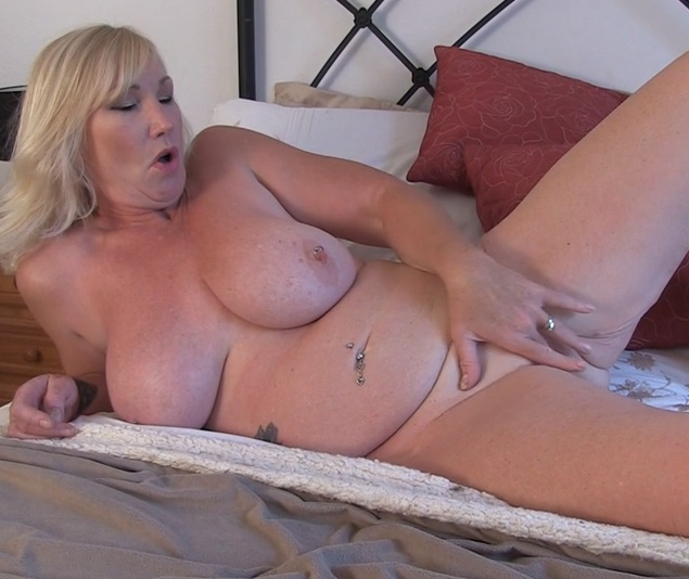 British big breasted cougar fingering herself