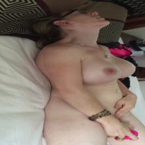 Busty horny wife vibrating her clit