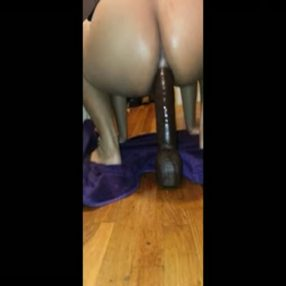 Wife riding a huge dong in her ass