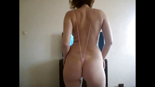 Wife in monokini shakes her ass