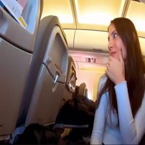 Naughty girl swallows on a crowded plane